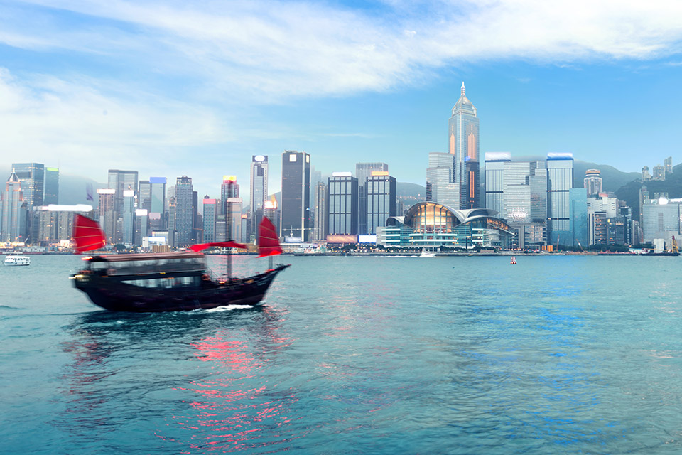 Paifang International Expertise - Boat with red sails entering Hong Kong harbour